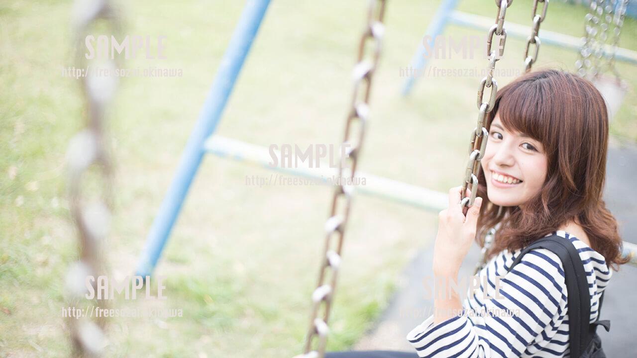 【伊計島】ブランコに乗る美少女 写真素材