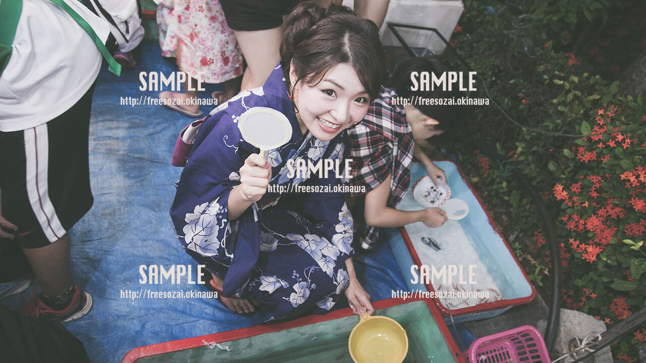 【てだこ祭り】夕日と浴衣の女の子 写真素材